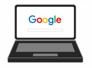 מחשב נייד פתוח על גוגל